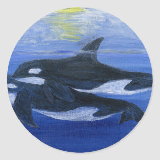 Orcas swimming classic round sticker
