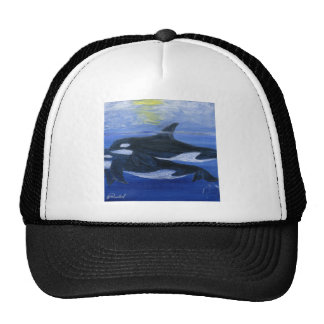 Orcas swimming trucker hat