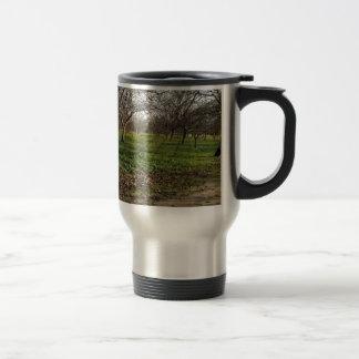 orchard trees landscape 15 oz stainless steel travel mug