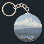 "Oregon Mount Hood Photo Keychain<br><div class=""desc"">Metal badge style key chain featuring the scenic photo image of a scenic valley beneath Oregon&#39;s crowned jewel,  Mount Hood. Select your key chain style. Makes a great travel souvenir! To see other products we have to offer,  click on the Northwestphotos store link.</div>"