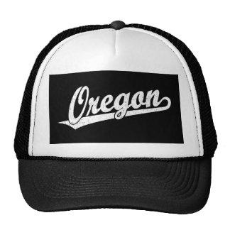Oregon script logo in white distressed trucker hat