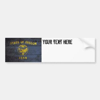 Oregon State Flag on Old Wood Grain Bumper Sticker