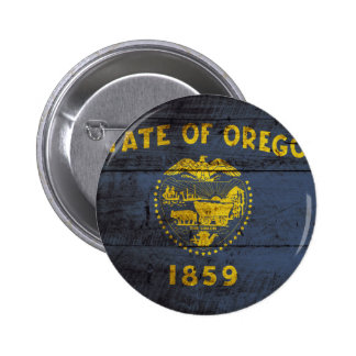 Oregon State Flag on Old Wood Grain Button
