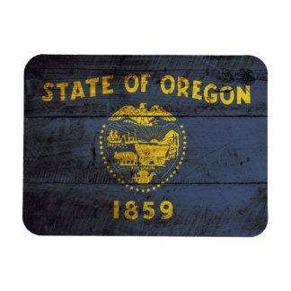 Oregon State Flag on Old Wood Grain Rectangular Photo Magnet