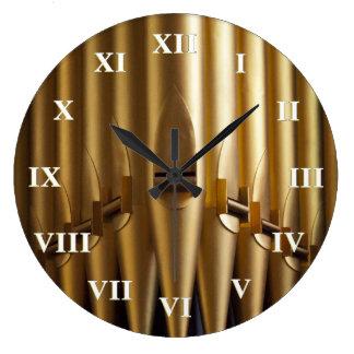 Organ pipes round clock - roman numerals