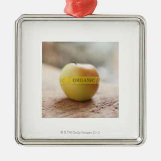 Organic sticker on apple square metal christmas ornament