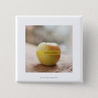 Organic sticker on apple pinback button