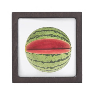 Organic watermelon with a slice cut into it, on jewelry box