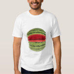 Organic watermelon with a slice cut into it, on tee shirt