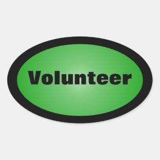 Orgulloso ser un voluntario dedicado pegatina ovalada