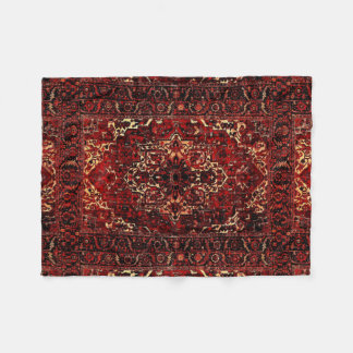 Oriental rug design in dark red fleece blanket