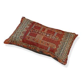 Oriental rug design in orange dog bed