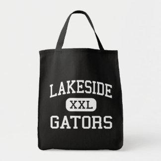 Orilla del lago - cocodrilos - joven - parque anar bolsas lienzo