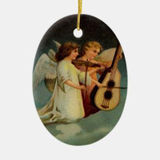 Ornamento de los ángeles de la velada musical adorno ovalado de cerámica
