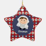 Ornamento del astronauta de las estrellas rojas y  ornamento de navidad