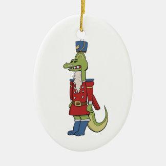Ornamento del cascanueces del dinosaurio adorno navideño ovalado de cerámica