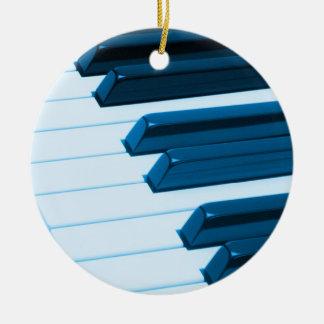 Ornamento del navidad de las llaves del piano o adorno navideño redondo de cerámica