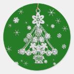 Ornamento y copos de nieve del árbol pegatina redonda