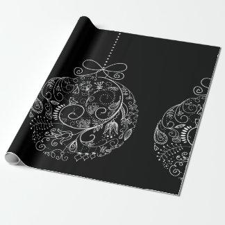 Ornamentos afiligranados en el papel de embalaje papel de regalo