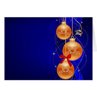 Ornamentos del árbol de navidad del oro con el fon tarjeta de felicitación