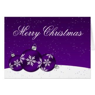 Ornamentos del copo de nieve del navidad púrpura y tarjeta de felicitación