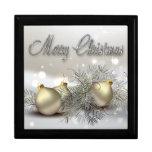 Ornamentos del navidad del reflejo del oro y de la caja de recuerdo