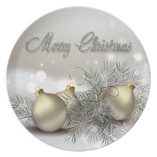 Ornamentos del navidad del reflejo del oro y de la platos