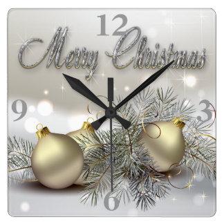 Ornamentos del navidad del reflejo del oro y de la reloj cuadrado