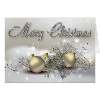 Ornamentos del navidad del reflejo del oro y de la tarjeta de felicitación