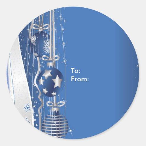 Ornamentos del navidad en etiquetas azules del etiqueta redonda