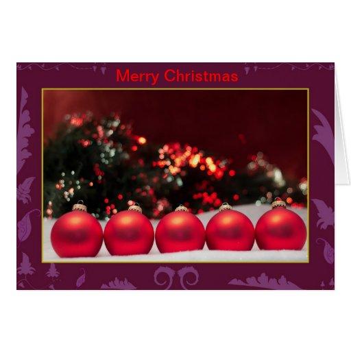 Ornamentos del rojo del navidad felicitacion