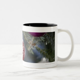Ornaments on a Christmas tree Two-Tone Coffee Mug