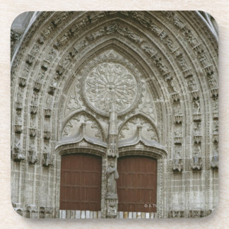 Ornate archway entrance with old-fashioned drink coaster