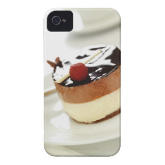 Ornate cheesecake on plate with coffee cup in Case-Mate iPhone 4 case