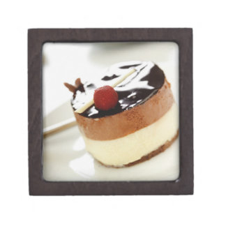 Ornate cheesecake on plate with coffee cup in premium trinket box