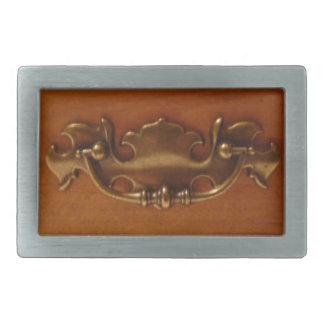Ornate Drawer Pull Handle on Wood Belt Buckle