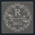 """Ornate Floral Chalkboard Monogram Wedding Year Stone Coaster<br><div class=""""desc"""">Celebrate the wedding year or anniversary of your favorite bride and groom with this customized keepsake! A fancy,  elegantly detailed white scroll and flower border on a black chalkboard background surrounds a monogram,  couple&#39;s names and wedding year. Makes a beautiful,  modern,  personalized gift.</div>"""