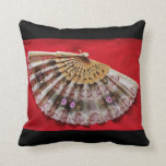 Ornate Hand Held Fan on a Red Background Throw Pillows