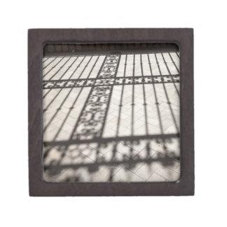 ornate iron fencing shadow on tile floor keepsake box