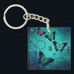 "Ornate Jewel Butterflies Keychain<br><div class=""desc"">Pretty and ornate butterfly art on blue textured background.</div>"