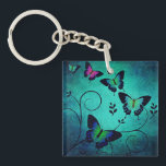"""Ornate Jewel Butterflies Keychain<br><div class=""""desc"""">Pretty and ornate butterfly art on blue textured background.</div>"""