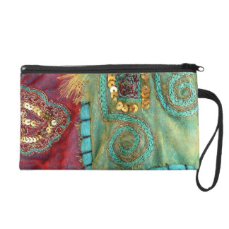 ornate stiching mf wristlet purses