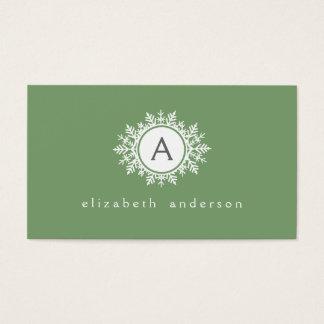 Ornate White Snowflake Monogram on Sage Green Business Card