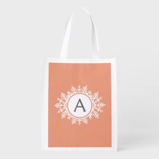 Ornate White Snowflake Monogram on Soft Coral Pink Reusable Grocery Bag