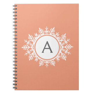Ornate White Snowflake Monogram on Soft Coral Pink Spiral Notebook