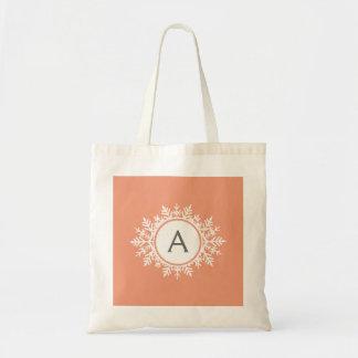 Ornate White Snowflake Monogram on Soft Coral Pink Tote Bag