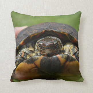 Ornate wood turtle in hand throw pillow