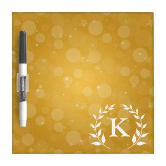 Oro Bokeh y monograma del laurel Pizarra