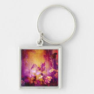Oro bonito y llavero púrpura de la mariposa del