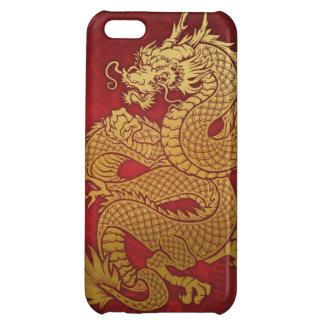 Oro chino en espiral del dragón en rojo